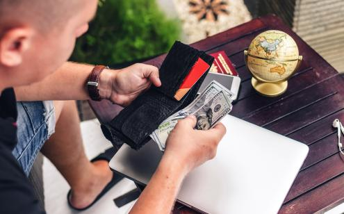 Consumer with cash and credit card